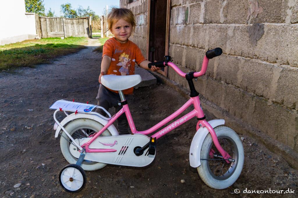 Poor girl with new bike